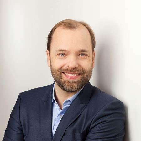 Dr. Schumann, Rene